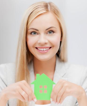 busineswoman: smiling busineswoman with green eco house symbol