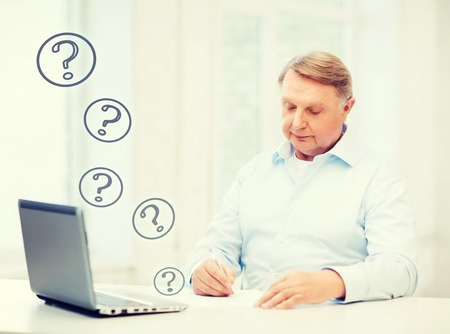 old writing: old man filling a form at home Stock Photo