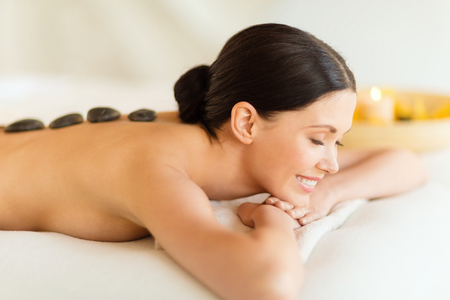 salon and spa: woman in spa salon with hot stones