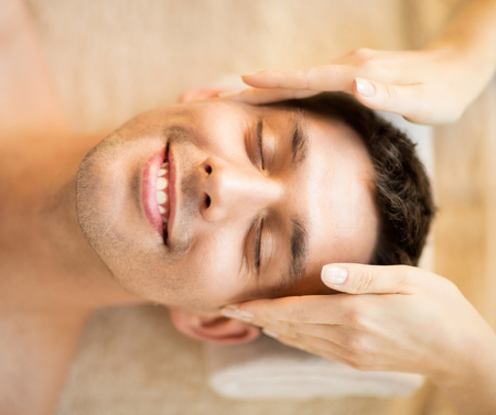 male massage: man is getting massage at in spa salon
