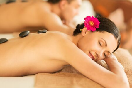 hot stones: picture of couple in spa salon with hot stones