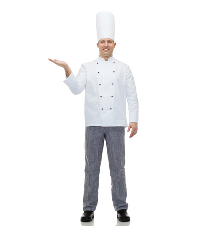 empty of people: cooking, profession, advertisement and people concept - happy male chef cook showing something on empty palm