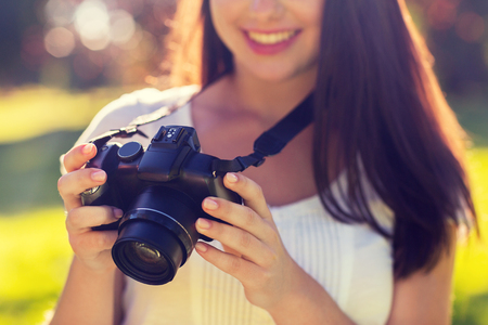 girl with camera: lifestyle, summer, vacation, technology and people concept - close up of young girl with photo camera outdoors Stock Photo