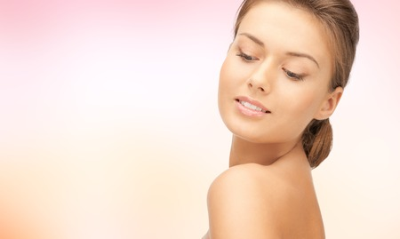 beauty woman: beauty, people and health concept - beautiful young woman face over pink background