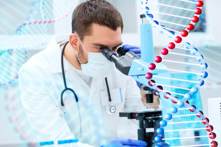 man looking: science, medicine, technology, biology and people concept - young male scientist looking to sample through microscope and making test or research in clinical laboratory over dna molecule structure