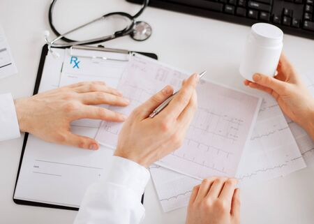 prescribing: healthcare, hospital and medical concept - two doctors prescribing medication Stock Photo