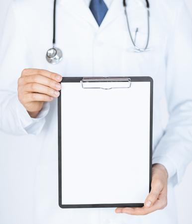 contact sheet: close up of doctor holding blank white paper
