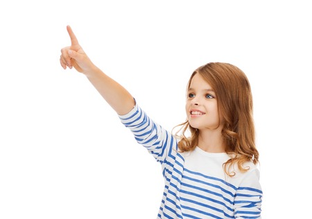 virtual school: education, school and virtual screen concept - cute little girl pointing in the air or virtual screen