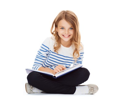 kids reading book: education and school concept - little student girl sitting on floor and reading book
