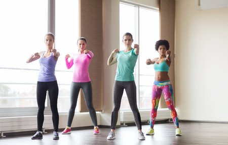 martial arts woman: fitness, sport, training, gym and martial arts concept - group of women working out and fighting in gym Stock Photo