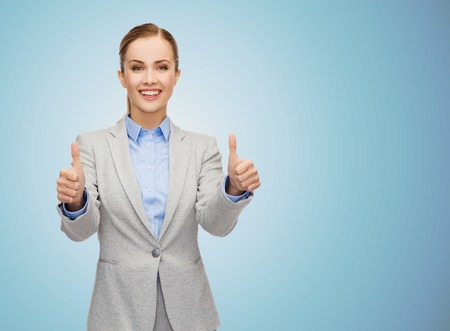 executive woman: business, education, gesture and people concept - smiling businesswoman showing thumbs up over blue background