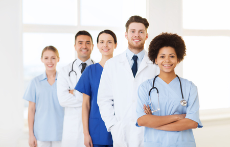 doctors smiling: hospital, profession, people and medicine concept - group of happy doctors at hospital
