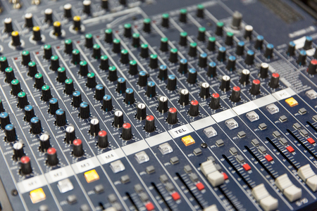 broadcasting: technology, electronics and equipment concept - control panel at recording studio or radio station