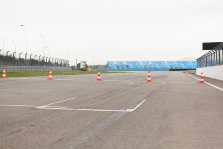 racing, motosports, extreme and motoring concept - empty speedway on stadium Stock Photo
