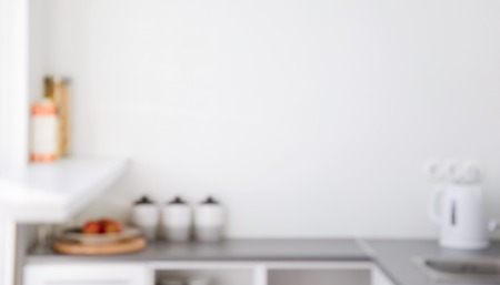 out of focus: interior and cooking concept - blurred kitchen interior background with copyspace Stock Photo