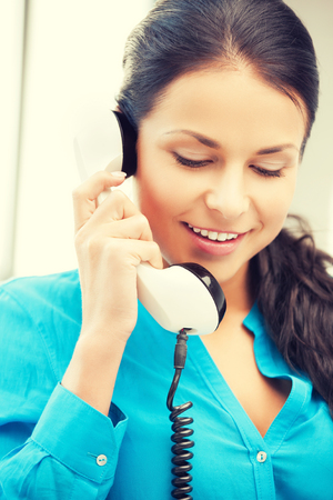 chit chat: picture of businesswoman with rotary phone calling