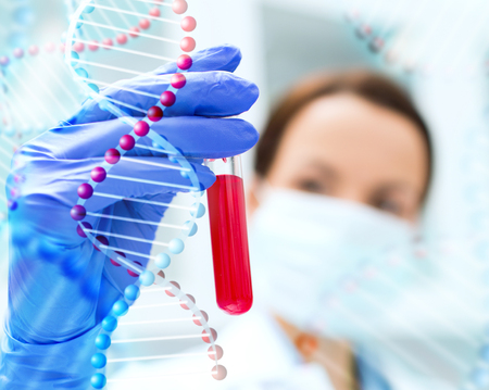 science, chemistry, biology, medicine and people concept - close up of young female scientist holding test tube with blood sample making research in clinical laboratory over dna molecule structure
