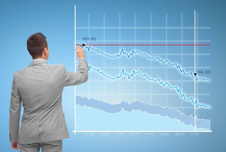 economical: business, people, statistics and economical crisis concept - businessman drawing virtual chart from back over blue background