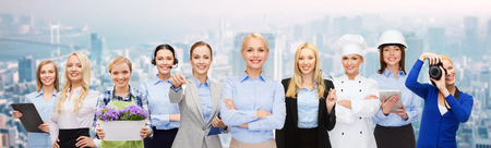 career: business, people and office concept - happy smiling businessman in suit pointing at you