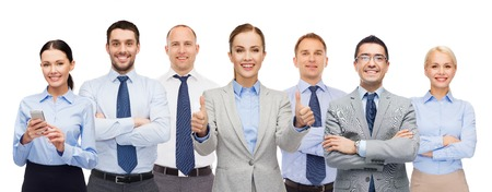 thumbs: business, people, corporate, teamwork and office concept - group of happy businesspeople showing thumbs up Stock Photo