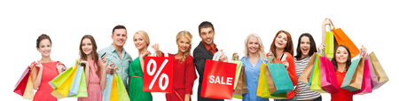 consumerism, people and discount concept - group of happy people with percentage and sale sign on shopping bags Stockfoto