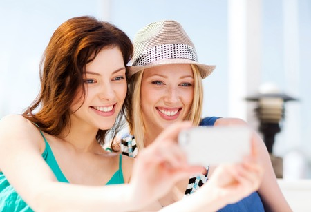 Summer Holidays And Vacation Girls Taking Photo In Cafe On