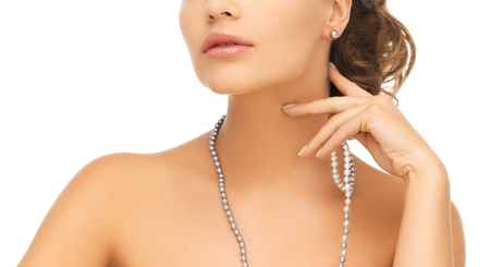 bride bangle: bride and wedding concept - beautiful woman wearing pearl earrings and necklace