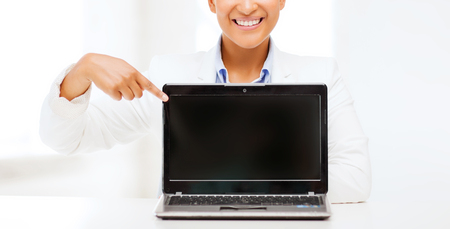 internet education: education,business, technology and internet concept - smiling woman with laptop computer
