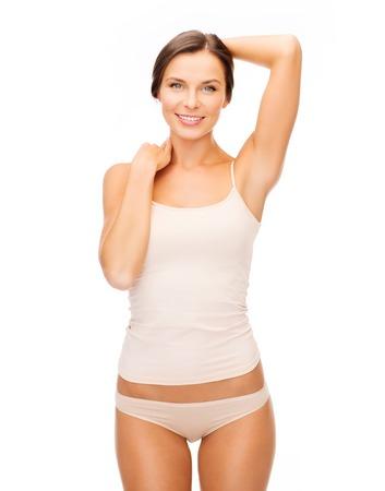 ropa interior: la salud y el concepto de la belleza - mujer hermosa en ropa interior de algodón de color beige