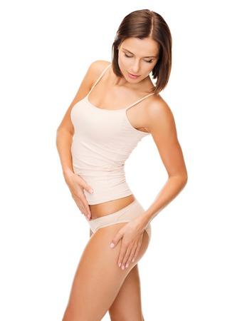 ropa interior: salud y belleza - mujer en ropa interior de algodón que muestra el concepto de adelgazamiento Foto de archivo