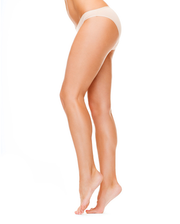 underwear: health and beauty concept - woman with long legs in cotton underwear Stock Photo