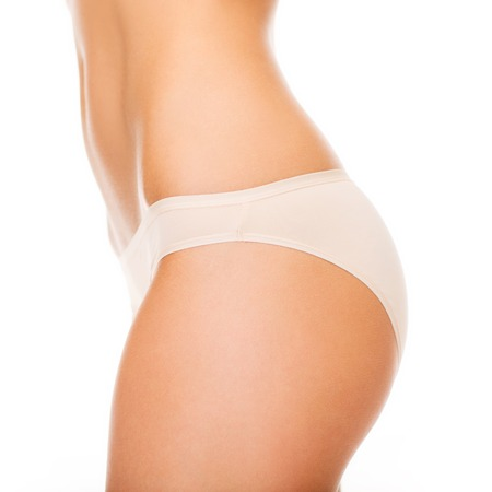 slim tummy: health and beauty - woman in cotton underwear showing slimming concept Stock Photo