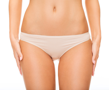 health and beauty - woman in cotton underwear showing slimming concept Stock Photo