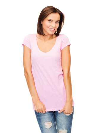 isolated woman: t-shirt design concept - smiling woman in blank pink t-shirt