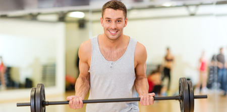musculine: fitness, sport, training, gym and lifestyle concept - smiling man with barbell in gym