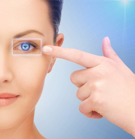 opthalmology: picture of beautiful woman pointing to eye