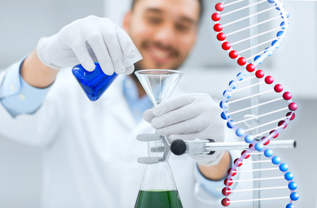 test tube holder: science, chemistry, biology, medicine and people concept - close up of scientist filling test tubes with funnel and making research in clinical laboratory