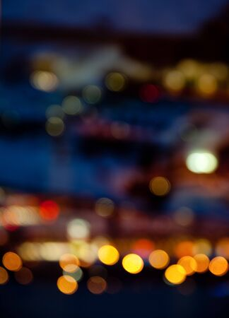 electricity background: holidays, illumination and electricity concept - colorful bright lights on dark night background