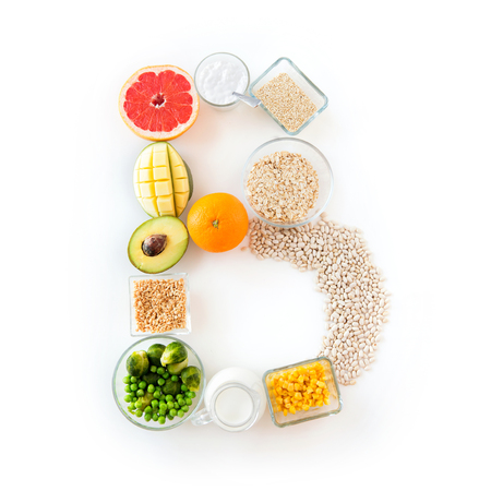 healthy eating, vegetarian food, diet and culinary concept - close up of food ingredients in letter b shape