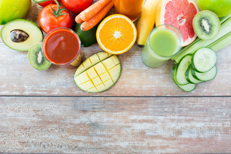 copies: healthy eating, food and diet concept - close up of fresh juice glass and fruits on table
