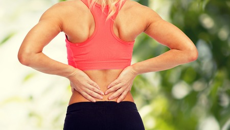 back up: fitness, healthcare and medicine concept - close up of sporty woman touching her back