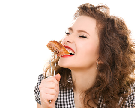 persons: paleo diet concept - young woman eating meat Stock Photo