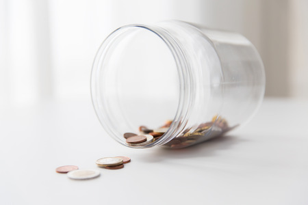 business, finance, investment, money saving and budget concept - close up of euro coins in glass jar on table Stock Photo