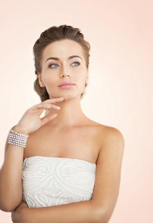 face female: beautiful bride wearing pearl earrings and bracelet