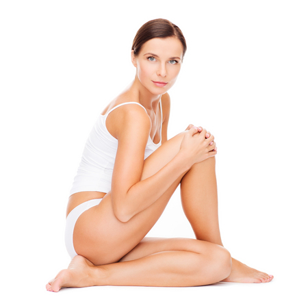 female body: health and beauty concept - beautiful woman in white cotton underwear