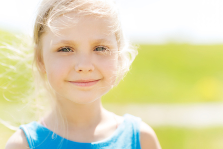 cute little girl smiling: summer, childhood, leisure and people concept - happy little girl outdoors