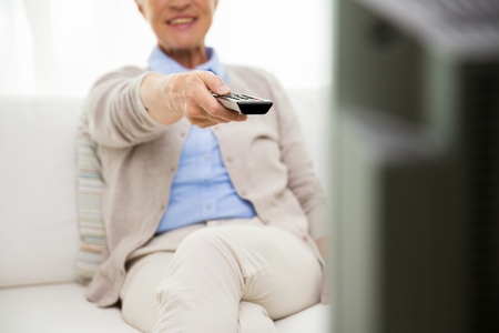 televisor: family, technology, television, age and people concept - close up of happy senior woman watching tv at home
