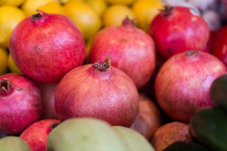 harvest: sale, harvest, food, fruits and agriculture concept - close up of pomegranate at street farmers market Stock Photo