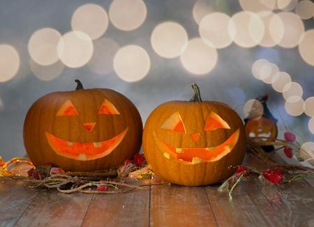 jackolantern: holidays, halloween and decoration concept - close up of pumpkins on table Stock Photo