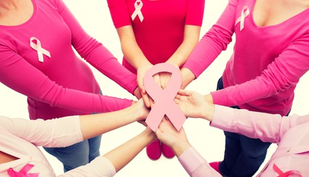 breasts girl: healthcare, people and medicine concept - close up of women in blank shirts with pink breast cancer awareness ribbons over white background